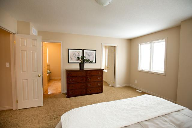 New homes norwich kitchener waterloo ayr woodstock for Model home master bedrooms